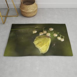 Yellow butterfly on lily of the valley flowers Rug