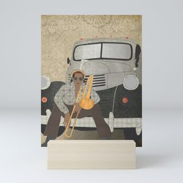 Trombone musician and his pickup truck Mini Art Print
