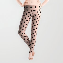 Small black polka dots on a pink beige background. Leggings