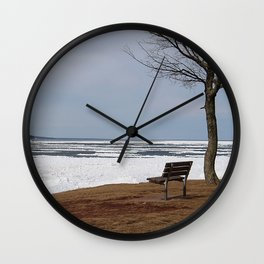 bench on frozen shore Wall Clock