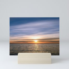 Sunset in the clouds over the lake water Mini Art Print