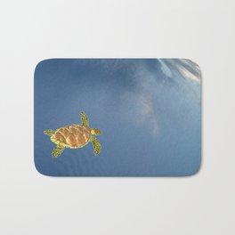 hawksbill swimming in the sky Bath Mat