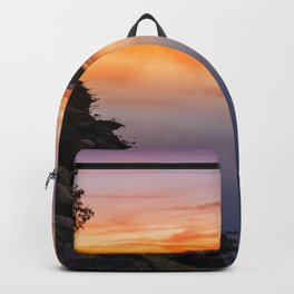 Orange sunset by the river Backpack