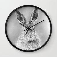 hare Wall Clocks featuring Hare by Mark Ferris