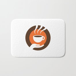 coffee cup in hand Bath Mat