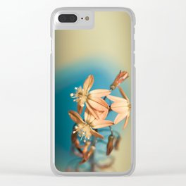 Bulbine flower on blue and bronze Clear iPhone Case