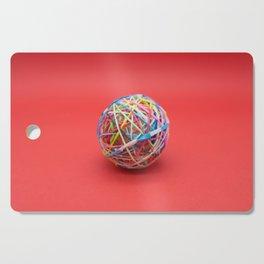 ball made with elastics Cutting Board