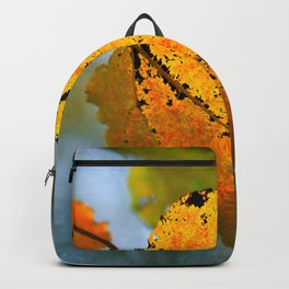 Yellow Aspen Leaf, Green Background. The Beauty Of The Autumn Season Backpack