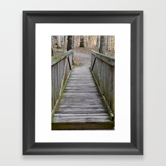 Walking over the bridge and through the woods Framed Art Print