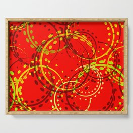 Mustard curls and circles of yellow and brown shades on a red background. Serving Tray