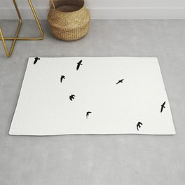A Murder of Crows In Flight Silhouette Rug