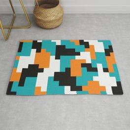 Color blocking shapes orange, teal Rug