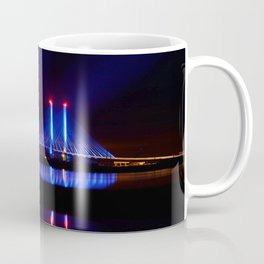 The Indian River Inlet bridge reflecting off the bay as beams of blue light penetrate the night sky Coffee Mug