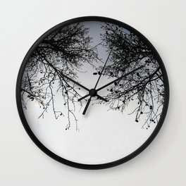 Black and white branches against sky Wall Clock