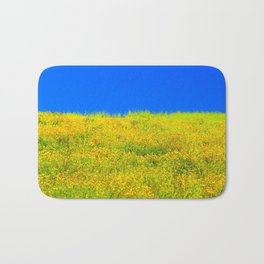 yellow poppy flower field with green leaf and clear blue sky Bath Mat