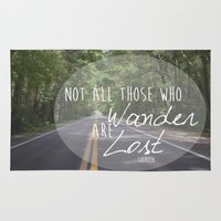 not all who wander Area & Throw Rugs featuring Not all those who wander... by AnchorMySoul