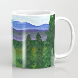 View from a mountain slope to distant mountains and forests Coffee Mug