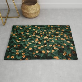 Yellow flowers bloom on green leaves background- beautiful natural photography Rug