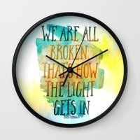 hemingway Wall Clocks featuring We are All Broken Ernest Hemingway Quote by Ginkelmier