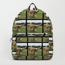 Brown and White Longhorn Standing in Pasture Backpack