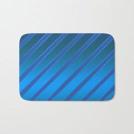 Oblique blue stripes on a blue satin background . Bath Mat