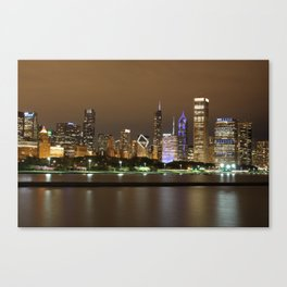 Beautiful river side city view in the night with colorful lights and tall buildings Canvas Print