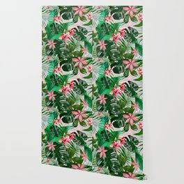 Tropical palm leaf with red flowers Wallpaper