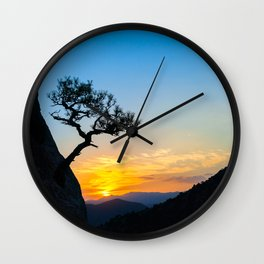 Sunrise in mountains with tree and sea. Wall Clock