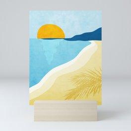 Empty beach at sunset. Mini Art Print