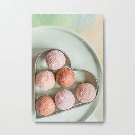 Golden delicious chocolate balls in heart shaped metallic cookie cutter on plate view from above Metal Print