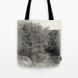 Black and white study of a tranquil river Tote Bag