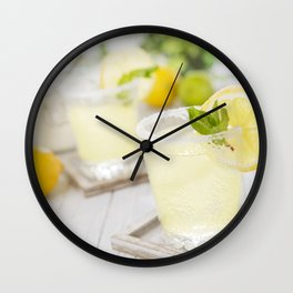 Refreshing lemonade on a rustic outdoor table in bright light Wall Clock