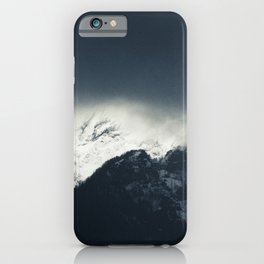 Darkness and light on snow covered mountains iPhone Case