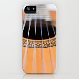 Strings of the guitar above the rose window iPhone Case