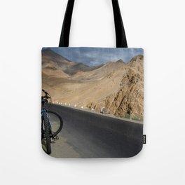 Mountain Biking down from Khardung La Tote Bag