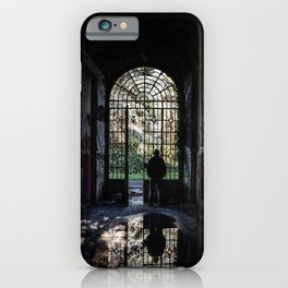 Silhouette of a man observing the outside world looking from the grate of a door iPhone Case