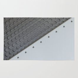White plate with rivets and circular metal grille Rug