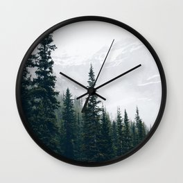 Evergreens in the fog Wall Clock