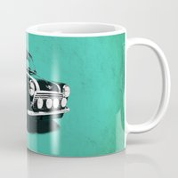mini cooper Mugs featuring The Mini Cooper by Mark Rogan