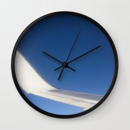 Airplane Wingtip on a blue sky Wall Clock