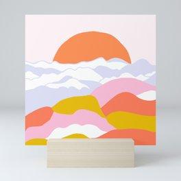 above the clouds Mini Art Print