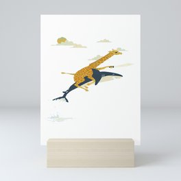 Giraffe riding shark Mini Art Print
