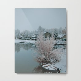 Canoe on a snowy lake in Colorado Metal Print