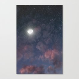 Glowing Moon on the night sky through pink clouds Canvas Print