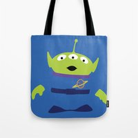 toy story Tote Bags featuring Toy Story Alien by TracingHorses