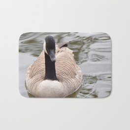 Beautiful Canadian Goose Swimming On Peaceful Pond Bath Mat