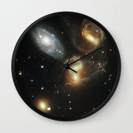 Galactic wreckage Wall Clock