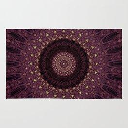 Mandala in dark purple and golden colors Rug