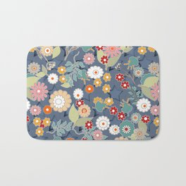Colorful flowers on a denim background. Bath Mat