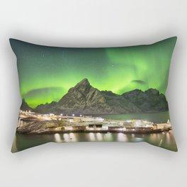 Aurora borealis over a village on the Lofoten in Norway Rectangular Pillow